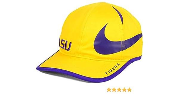 51eb682d9c8 Amazon.com   Nike Aerobill Dri Fit Adjustable Lightweight LSU Tigers Cap Hat  (Gold