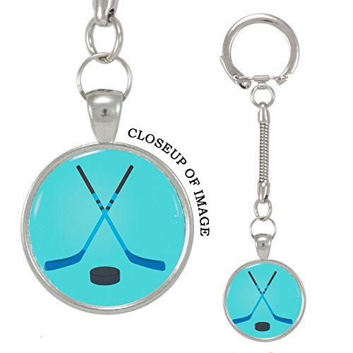 Price comparison product image Vector Illustration of Crossed Hockey Sticks and Puck Keychain