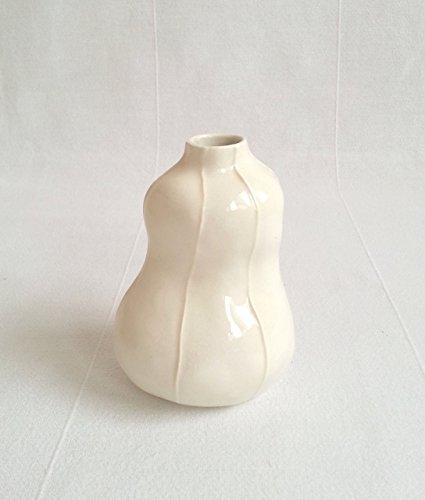 (VIT ceramics bud vase from Kri Kri Studio. Handmade ceramic torso shaped flower vase. Natural white with raised white stripes)