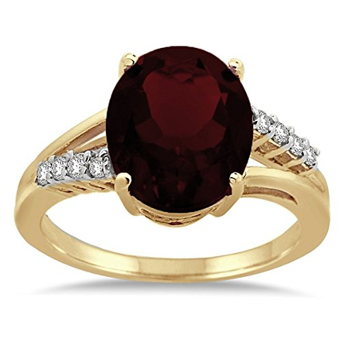 (Oval Shaped Garnet and Diamond Ring in 10K Yellow Gold)