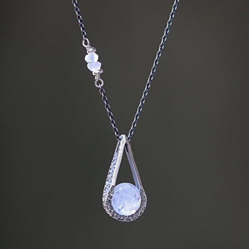 Silver teardrop pendant necklace with round faceted moonstone gemstone and moonstone beads on the side on oxidized sterling silver chain