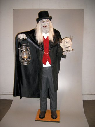 Halloween Decor: 5 1/2' Scaretaker Animated Prop - Product Description - Evil Scaretaker'S Whole Body Shakes And Wobbles While Glaring At You As His Jaw Moves Up And Down. The (Scaretaker Animated Prop)