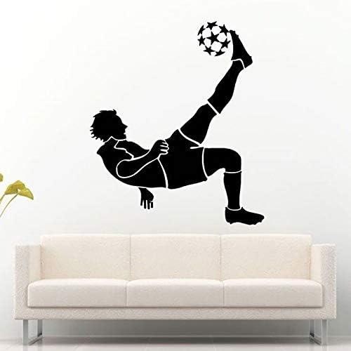 Jugador de fútbol Futbolista Jugando a la Pelota con el pie ...