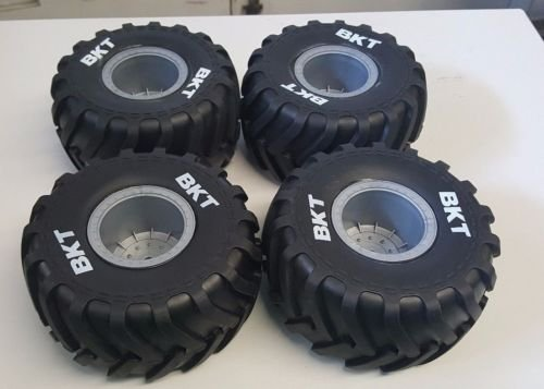 AXIAL 1/10 GRAVE DIGGER TIRES, THESE TIRES MAKE ANY TRUCK LOOK FANTASTIC, WITH THE WHITE LETTERING TO HELP THEM STAND OUT