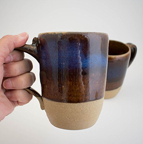 Handthrown ceramic Coffee Mug in Dark Brown with a band of bright blue. Holds 14 Ounces