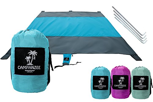 Campanzee Beach Blanket by Sand Free, Oversized 9 x 10 Ft, and Water Proof For Outdoor Use as a Camping, Festival, or Picnic Blanket | 5 Sand Pockets, Rip-Stop Nylon Fabric, and 4 Anchor Stakes
