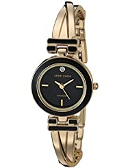 Anne Klein Women's AK/2622BKGB Diamond-Accented Gold-Tone Crossover Bangle Watch