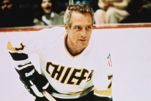 bbc12a9add4 Image Unavailable. Image not available for. Color  Paul Newman Slap Shot in  Chiefs shirt on ice with hockey stick 24X36 Movie Poster