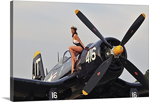 Christian Kieffer Gallery-Wrapped Canvas entitled 1940's style Navy pin-up girl sitting on a vintage Corsair fighter plane by greatBIGcanvas