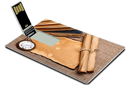 Above Antique Style Clock (MSD 32GB USB Flash Drive 2.0 Memory Stick Credit Card Size Above view of old pocket watch with vintage paper rolls and aged books Burlap IMAGE)