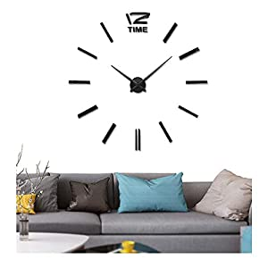 Wall clock above a gray couch