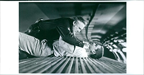 Vintage photo of A photo of an American actor, filmmaker, photographer, and artist Dennis Hopper and a Canadian actor, producer, director and musician Keanu Reaves Fighting in the movie Speed. 1994
