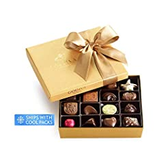 Inside this iconic 19-piece Gold Gift Box from Godiva you'll discover the best of Belgian chocolate. This exceptional assortment includes the finest chocolates, featuring milk, dark, and white chocolates with classic Belgian fillings such as ...