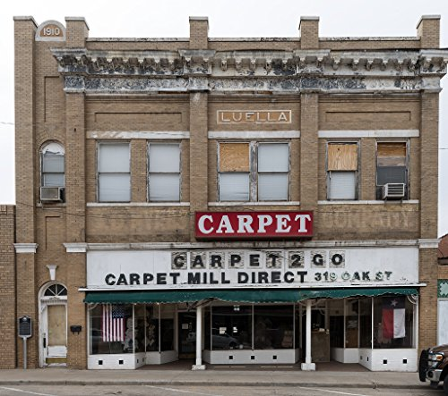24 x 36 Giclee print ofA carpet store in the historic Myers Building in Sweetwater Texas. Mayor of Sweetwater in the early 1900s S.D. Myers ran a saddlery in this - Location Myer Store