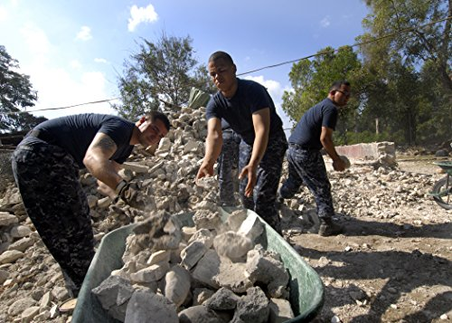 Home Comforts Laminated Poster Sailors assigned to The Amphibious Dock Landing Ship USS Carter Hall (LSD 50) Pile Rubble in wheelb Vivid Imagery Poster Print 24 x 36