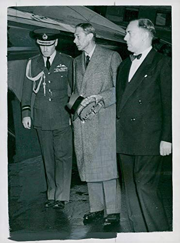Vintage photo of King George at London Airport
