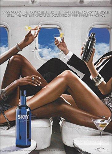 print-ad-for-skyy-vodka-airplane-scene-iconic-blue-bottle