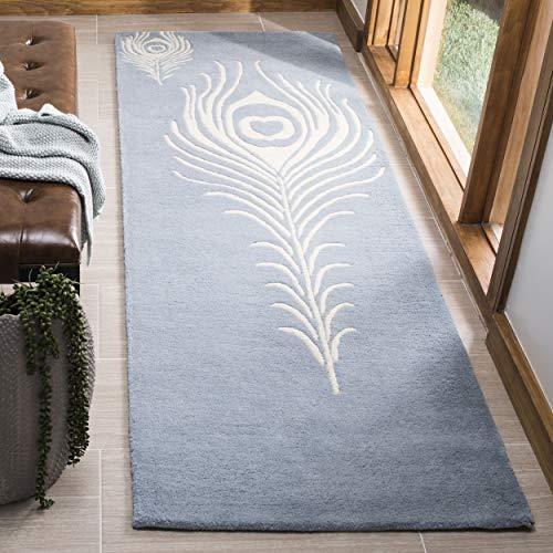 - Safavieh Soho Collection SOH704B Handmade Light Blue and Ivory Premium Wool Area Rug (2'6