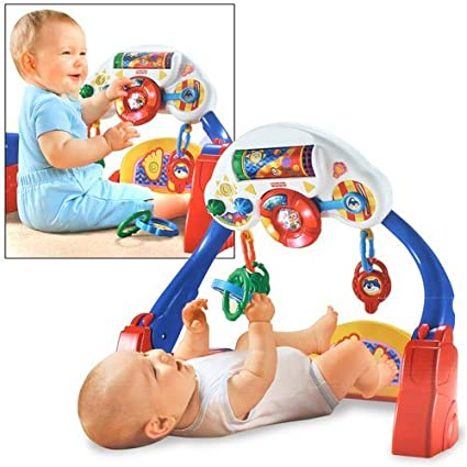 Amazon.com: Fisher-Price Brilliant Basics Kick & Drive ...