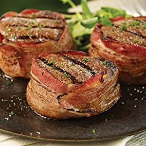 Omaha Steaks Family Savings Pack Features Bacon Wrapped Filet Mignon, Omaha Steaks Burgers and Stuffed Baked Potatoes