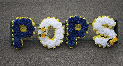 handmade funeral tribute in artificial flowers name 4 letters or