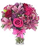 Send flowers to celebrate every occasion! This beautiful floral bouquet is a stunning gift to send for a birthday, anniversary or to say get well or just because. Arranged with fresh flowers including red roses, pink roses, pink lilies and pu...