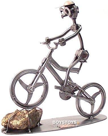 Bicicleta BMX de diseño de hombre sentado: Amazon.es: Hogar