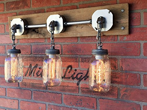 THE JARS OF LIGHT - A triple Mason jar wall sconce chandelier light with exposed conduit on reclaimed wood | MillerLights Original. by MillerLights
