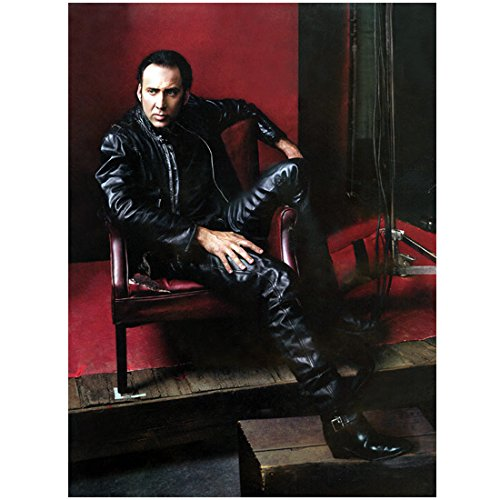Nicolas Cage 8 X 10 Photo All Black Leather Draped Over Chair Red Background kn
