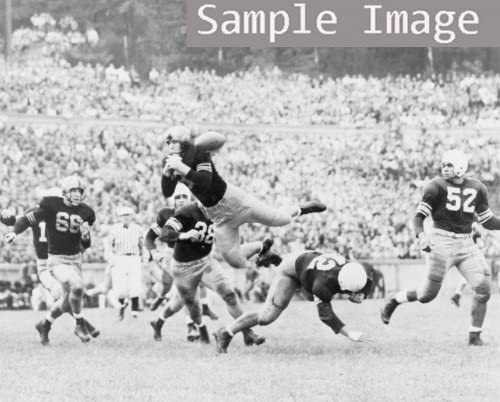 Army back 1930 Karl Kuckhahn leaps into the air but misses the ball as he b g6