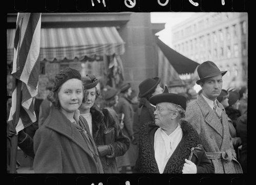 Photo: Watching parade, crowds, buildings, streets, Omaha, Nebraska, NE, John Vachon, 1938 . Size: 8 ()