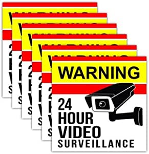 6 Pack Video Camera Security Stickers. Large 5 inches. Adhesive on the Front and Back for Windows, Walls, Doors. Give warning that your home or retail businesses is under 24hr surveillance recording.