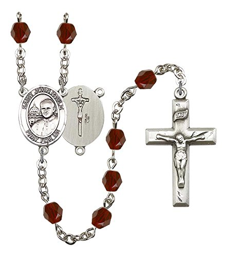Garnet Rosary Crucifix - Silver Plate Rosary features 6mm Garnet Fire Polished beads. The Crucifix measures 1 3/8 x 3/4. The centerpiece features a ST. JOHN PAUL II medal.