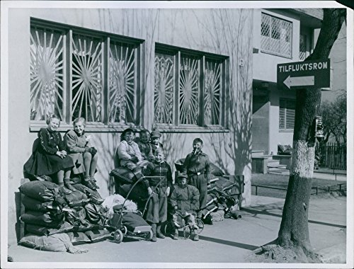 Vintage photo of Group of children sitting on stack of sack outside the shelter in Oslo as their Civilian air protection.