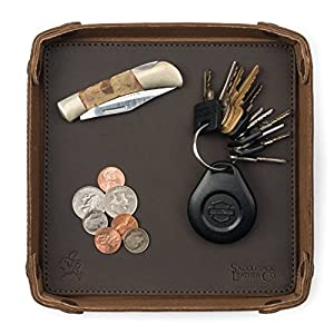 Top view of valet tray holding keys, coins, and a pocket knife