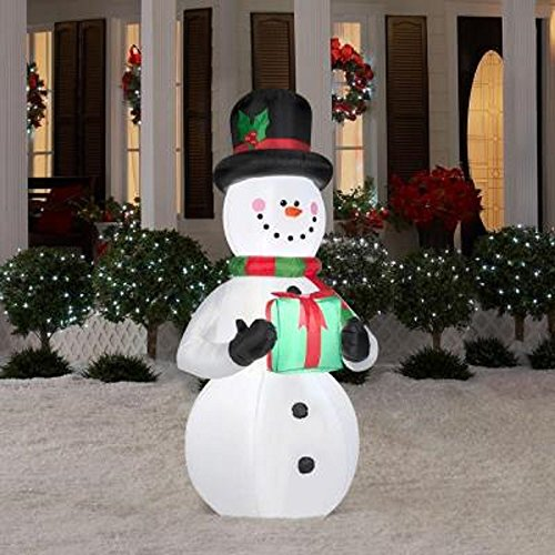 Gemmy Airblown Inflatable Snowman Holding a Green Present with Red Bow - Indoor Outdoor Holiday Decoration, 6.5-foot Tall