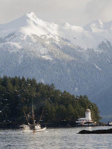 troller-heads-out-of-the-sitka-harbor-as-it-passes-by-the-rockwell-lighthouse-with-mt-longenbaugh-in