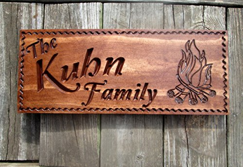 Personalized Carved Wooden Campfire Sign made our list of personalized camping gifts for RV camp and tent campers