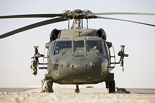 Posterazzi Front view of a UH-60L Black Hawk helicopter armed with two 7.62mm M240B machine guns on the doors Poster Print (17 x 11)