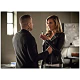 Kirk Acevedo 8 Inch x 10 Inch PHOTOGRAPH Arrow (TV Series 2012 -) Wearing Black Showing Dragon Tattoo Talking to Woman Holding Vial kn