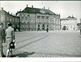 Vintage photo of Margrethe II of Denmark and Henrik, Prince Consort of Denmark walking on cobblestone.