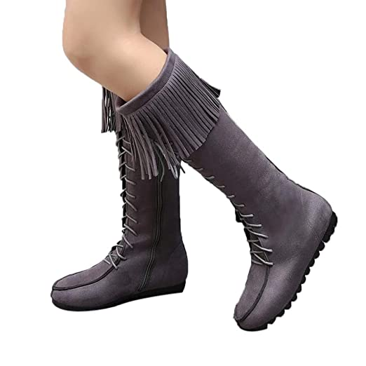 aca4c94ffde Amazon.com  Baigoods Lace Up Women Knee Long Boots Fringe Flat Heels Long  Boots Tassel Knee High Suede Long Snow Booties  Clothing