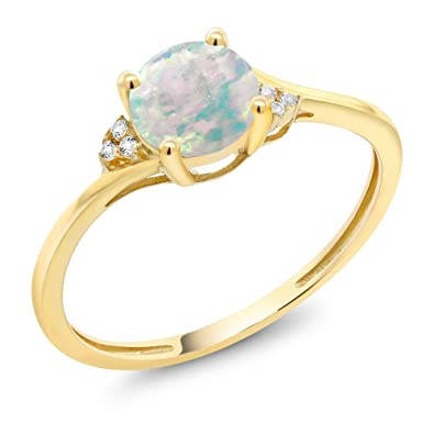 round imageurl engagement cabochon products ogi ring unique gold emerald surrounded with shape diamond halo colombian collections by ltd rings a white