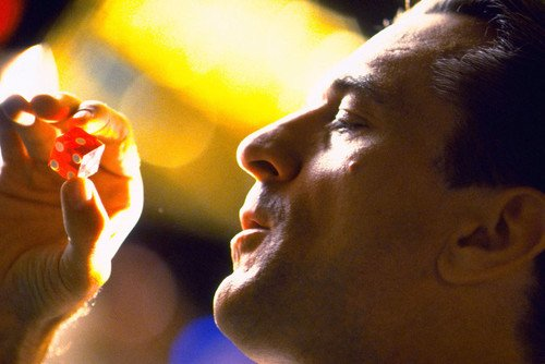 Robert De Niro in Casino Examining Dice in Profile Classic Image 11x17 Mini Poster