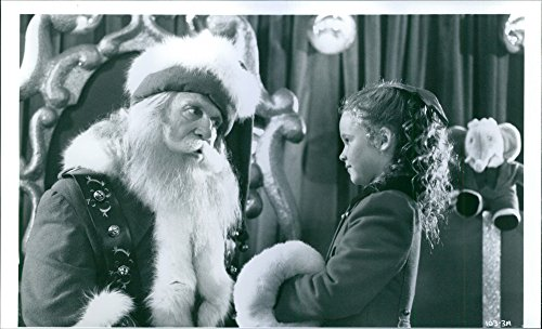 Birch Santa (Vintage photo of Thora Birch is shown talking to Santa Claus in the film, All I Want for Christmas.)