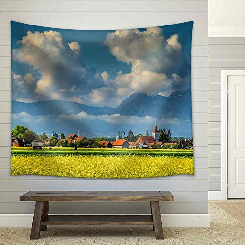 Spectacular Village with Canola Field and Cloudy Mountains in Background Near Brasov Transylvania Romania Europe Fabric Wall