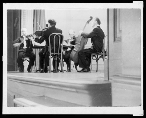 (1945 Photo Four members of a string quartet, performing in the Coolidge Auditorium, from a film on the Library of Congress, produced by the U.S. Office of War Information Location:)