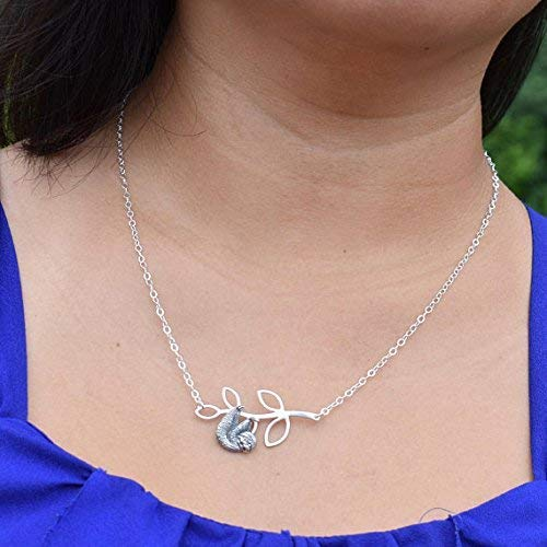 (Sloth Charm pendant hanging on leaf bar pendant in sterling silver with 20