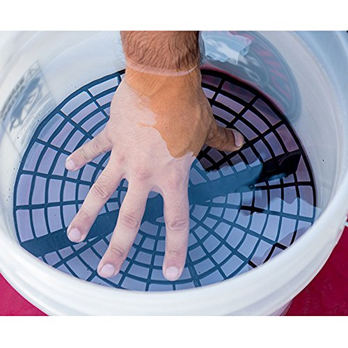 Hand pushing down the grit guard on the bucket with water.