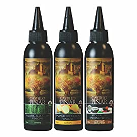 Castillo de Pinar 3-Pack Bundle - Thyme Balsamic Reduced Vinegar (150ml), Lemon Reduced Vinegar (150ml) and Coconut… 1 3-Pack Bundle - Thyme Balsamic Reduced Vinegar, Lemon Reduced Vinegar and Coconut & Coriander Spicy Peri-Peri USES - Syrupy, sweet-tart reduction has a myriad of uses! Drizzle the balsamic reduction on just about anything, like simple salads (like this tomato, basil, and cheese appetizer, as pictured), or use as a dip for antipasto skewers. QUALITY - Made with the finest Organic/ Non-GMO ingredients.